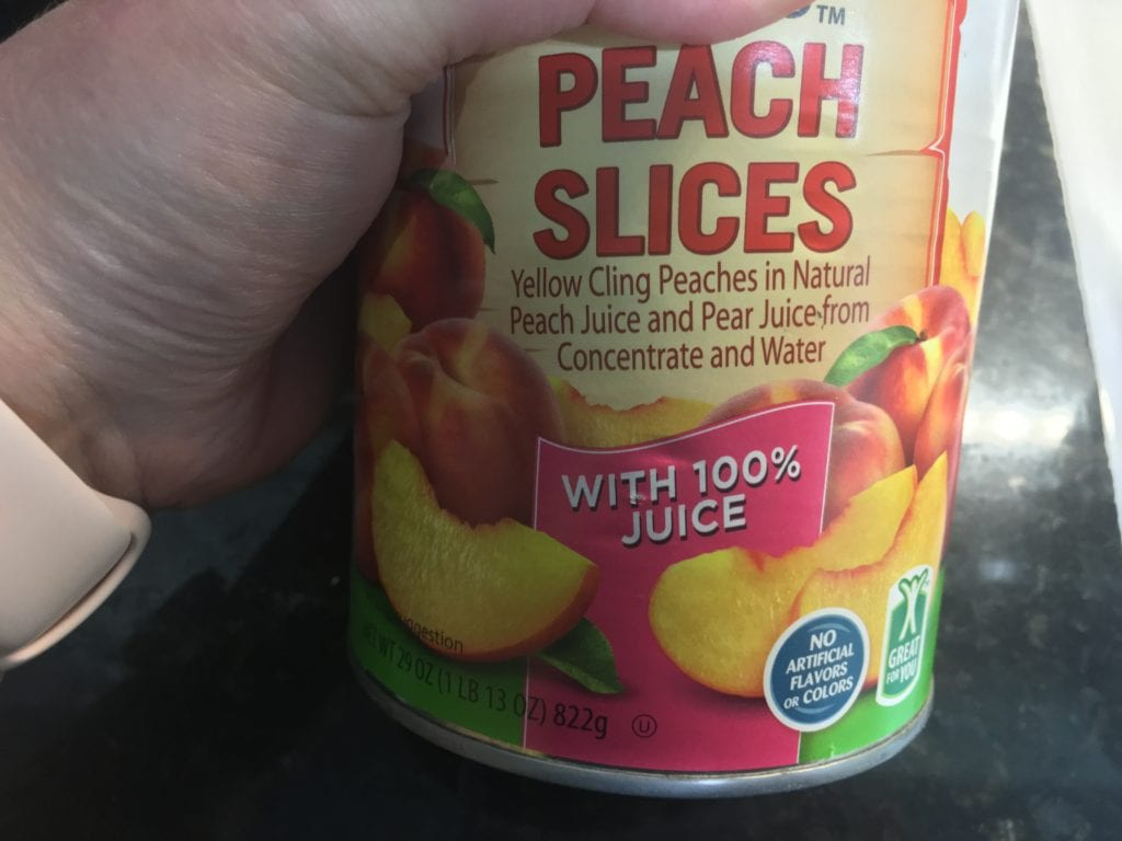 Canned peach slices in fruit juice.