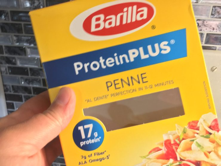 A yellow box of Barilla Protein Plus Penne Pasta.